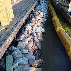 Riprap wall in front of deck